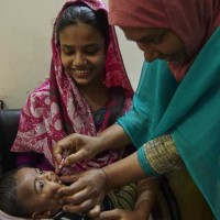 •	A child receives oral polio vaccine at an icddr,b field site in Mirpur, Dhaka. Photo: icddr,b / Shehzad Noorani